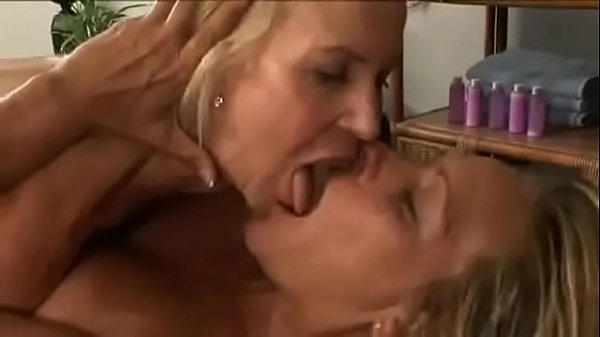 Lesbian massage seduction of a mature Blond