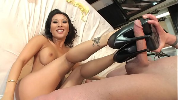 Asa Akira loves to tease guy's cock with her long sexy feet