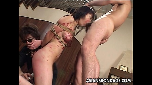 Cute Asian chick teased in bondage