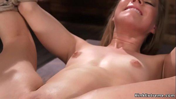 Petite blonde fucks machine in bondage