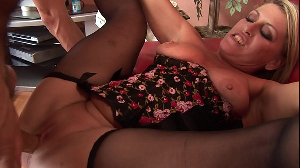 MILF slut in sexy lingerie sucks cock then sits on it on the sofa