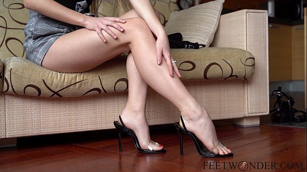 Sexy feet on high heels dangling