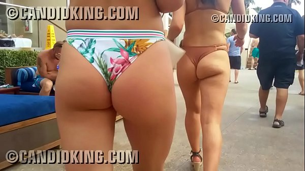 Pool party babes walking in tiny bikinis showing ass cheeks!